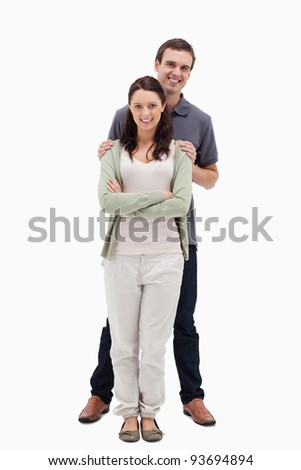 Man holding woman by the shoulders against white background