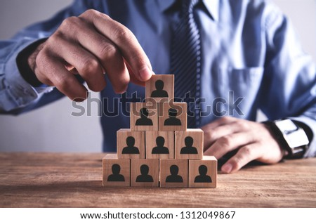 Man holding wooden cube. Human Resources Concept. Team Building #1312049867