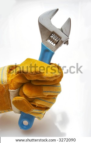 Man holding wrench with leather gloves