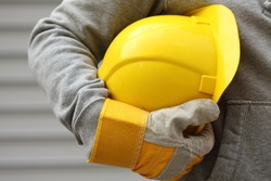 Man holding yellow helmet close up