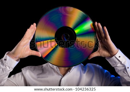 Man holds a retro laser disc instead of the head.