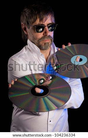 Man holds a retro laser discs on a black background.