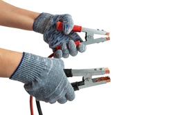 Man holds connecting cables in hand to connect battery
