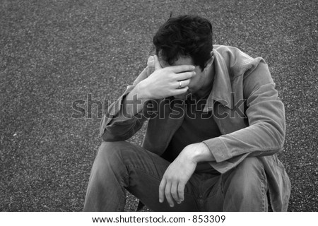Man holds his head down in sadness