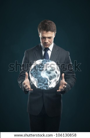 man holds in  hands an abstract Earth
