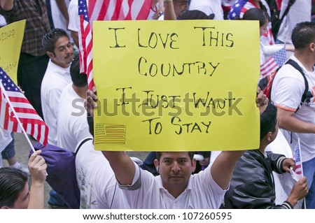 "Man holds sign saying ""I love this country"" in march for Immigrants and Mexicans protesting against Illegal Immigration reform by U.S. Congress, Los Angeles, CA, May 1, 2006"