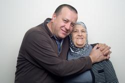 Man hugging his Mother wearing Hijab