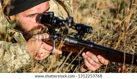 Man hunter with rifle gun. Boot camp. Bearded man hunter. Army forces. Camouflage. Military uniform fashion. Hunting skills and weapon equipment. How turn hunting into hobby. Strict verdict. #1312253768