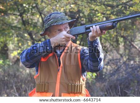 Man hunting and shooting a shot gun