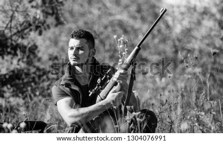 Man hunting wait for animal. Hunter with rifle ready to hunting nature background. Hunting strategy or method for locating targeting and killing targeted animal. Hunting skills and strategy.