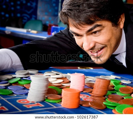 Man in a casino winning on the roulette