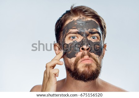 Man in a cosmetic mask                                #675156520