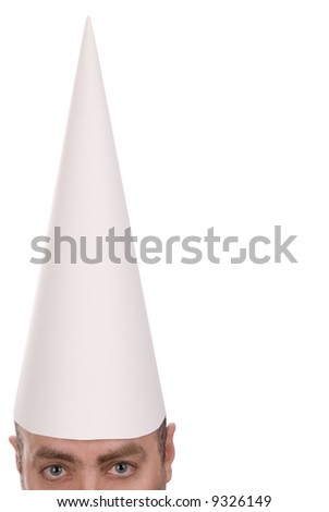 Man in a dunce cap over a white background