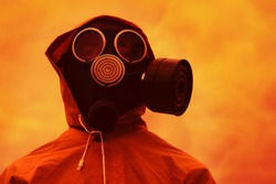 Man in a gas mask against a gloomy sky. End of the world concept