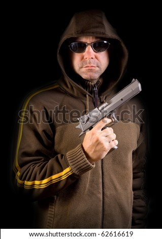 man in a hood with gun