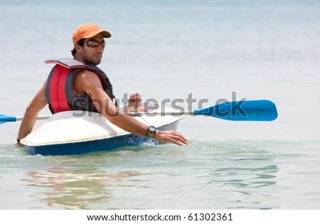 Man in a kayak on the ocean enjoying his holidays
