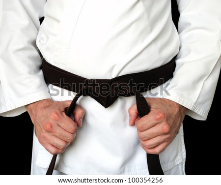 Man in a kimono and belt for martial arts