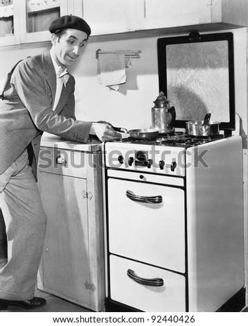 Man in a kitchen preparing food