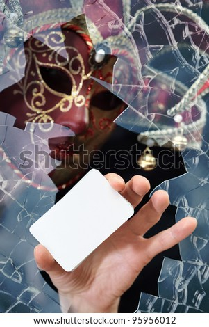Man in a mask with card , place your image on card.