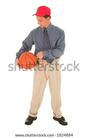 Man in a red cap, standing with basket ball and whistle.