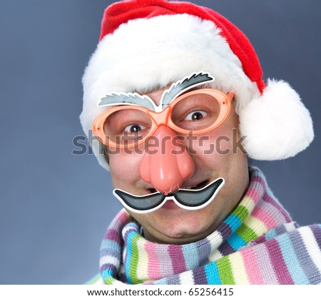 man in a ridiculous Santa Claus mask in the warm scarf