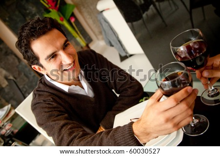Man in a romantic dinner toasting with wine - stock photo