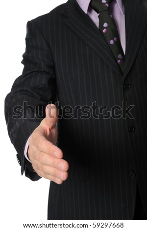 man in a suit holds out his hand for a handshake. Isolated on white background