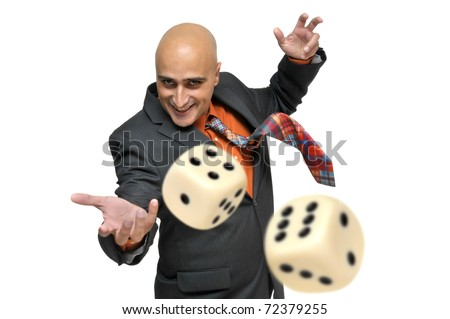 Man in a suit playing dice isolated in white