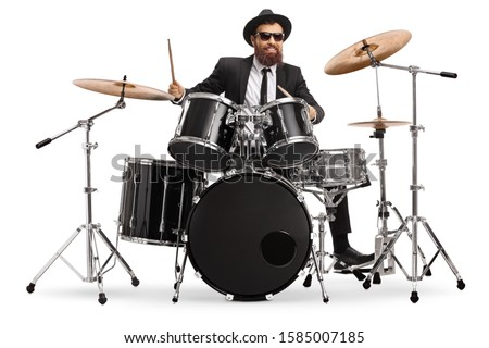 Man in a suit playing drums isolated on white background