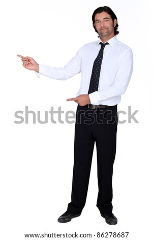 man in a suit pointing at something