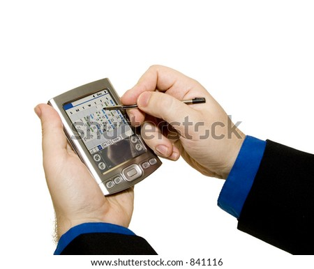 Man in a suite (only hands shown) working on his PDA computer. Clipping Path included.