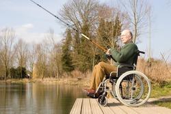 man in a wheelchair fishing