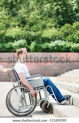 Man in a wheelchair in front of the stairs