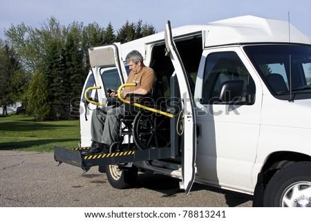 man in a wheelchair uses a wheelchair lift