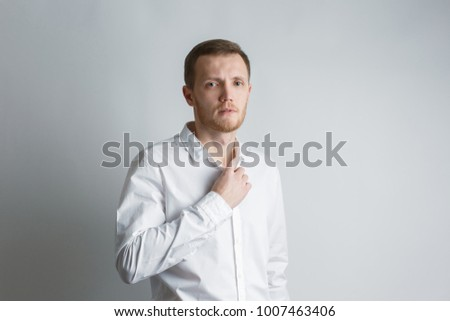 man in a white shirt buttoning his sleeves, businessman is going to work, on a white background #1007463406