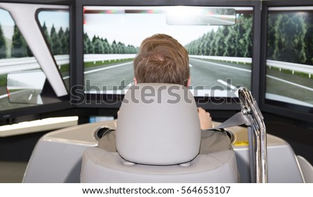 Man in an automotive simulator electric car  #564653107