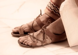 man in ancient roman sandals