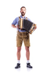 Man in bavarian clothes playing accordion and singing. Oktoberfe