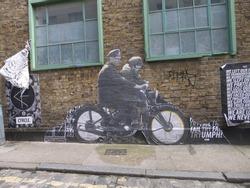 Man in bike at Brik Lane Street