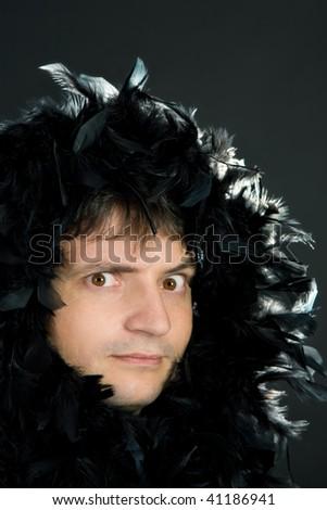 man in black feather boa - stock photo