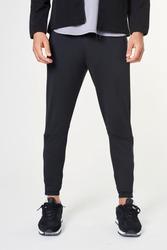 Man in black jogger pants mockup