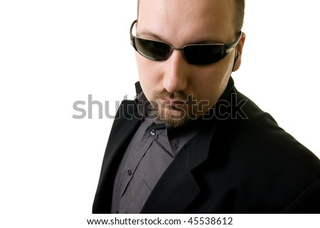 man in black suit and glasses