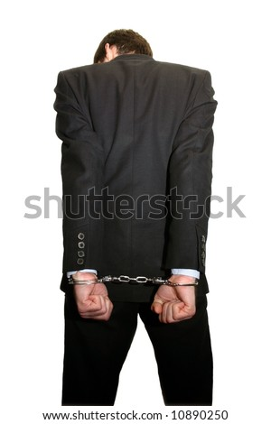 man in black suit and handcuffs from behind isolated on white