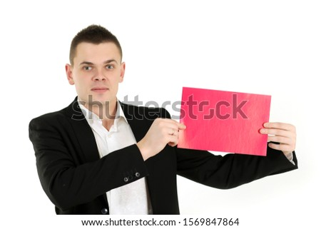 man in black suit with poster in hands