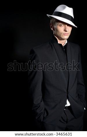 man in black suite and white hat - stock photo