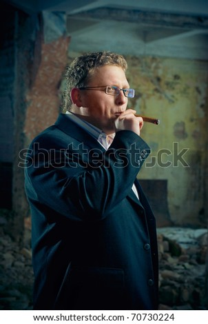 man in black suite in abandoned house. gangster boss theme