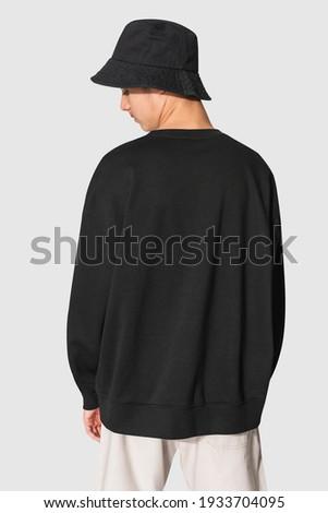 Man in black sweater and black bucket hat teen's apparel shoot Stock fotó ©
