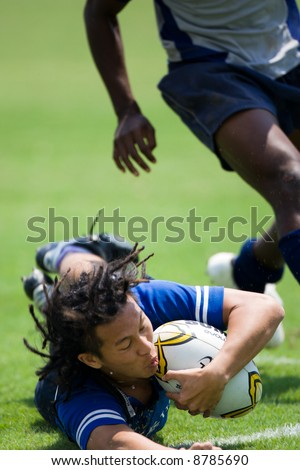 Man in Blue jersey saving a try at Rugby 7s 20007 event