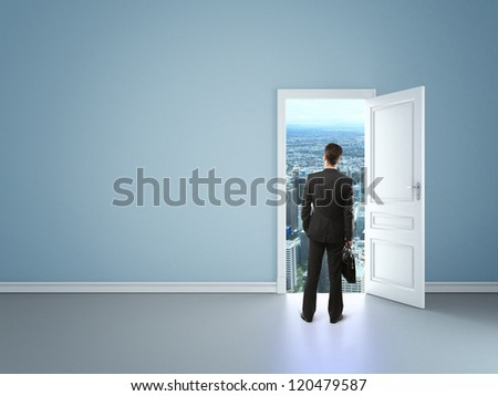 man in blue room with door in city