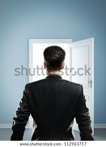 man in blue room with doors open